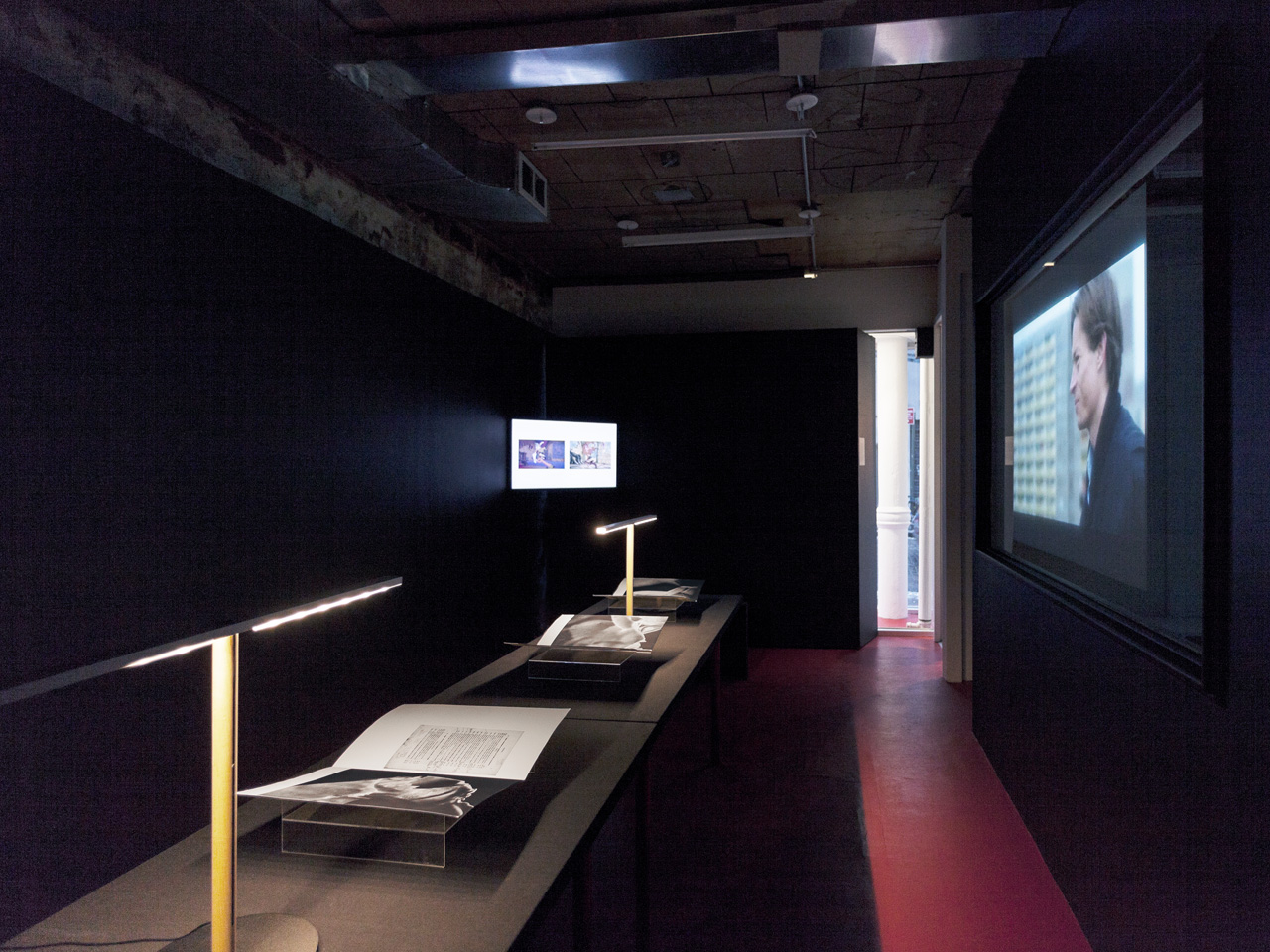 P!,  Exhibition view featuring Åbäke, Pieta in Reverse, 2012; Oliver Laric, Versions (Mandarin version), 2013; Amie Siegel, Berlin Remake, 2005